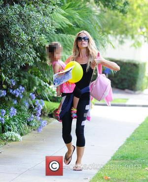 Denise Richards and Eloise Sheen - Denise Richards with her hands full as she carries her daughter Eloise in her...