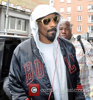 Snoop Dogg, Calvin Cordozar Broadus and Jr. - Snoop Dogg seen arriving at the back door of The Morrison hotel,...