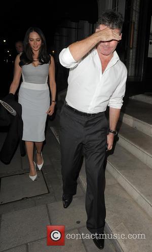 Lauren Silverman and Simon Cowell - Simon Cowell and Lauren Silverman leaving 34 restaurant, having dined with Piers Morgan. Simon...