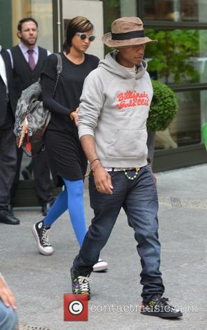 Pharrell and Helen Lasichanh