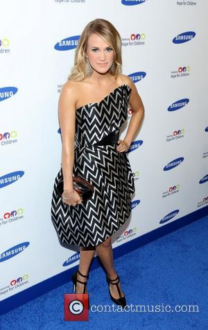 Carrie Underwood - Samsung Hope For Children Gala 2014 - Arrivals - New York, New York, United States - Wednesday...
