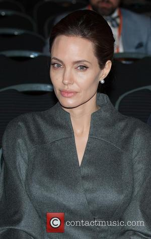 Angelina Jolie & Daniel Day-lewis Receive Top Honours From The Queen