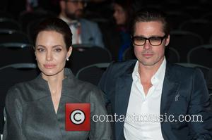 Angelina Jolie Reveals She And Brad Pitt Married In Secret Before Their French Wedding