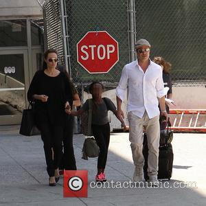 Angelina Jolie, Brad Pitt and Zahara Jolie-Pitt - Brad Pitt and Angelina Jolie arrive at Los Angeles International Airport (LAX)...