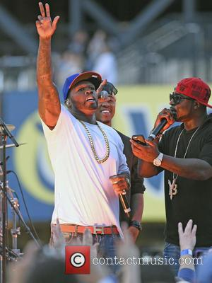 50 Cent and Curtis James Jackson III - 50 Cent performs live during a post-game concert at Citi Field on...