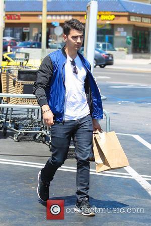Joe Jonas - Joe Jonas picks up food from Tender Greens to watch the United States men's national soccer team...