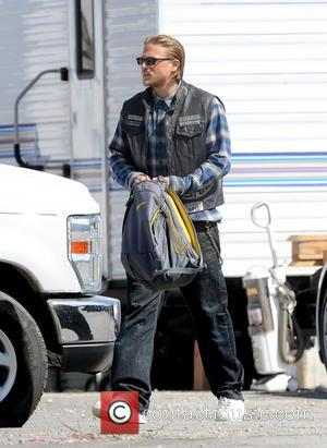 Charlie Hunnam - Charlie Hunnam signed autographs for awaiting fans as he rides off home on his Harley Davidson motorcycle...