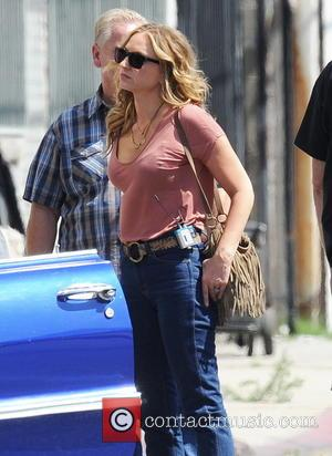 Drea De Matteo - Charlie Hunnam signed autographs for awaiting fans as he rides off home on his Harley Davidson...