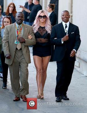 Kesha - Kesha is escorted as she arrives for a taping of the Jimmy Kimmel show - Los Angeles, California,...