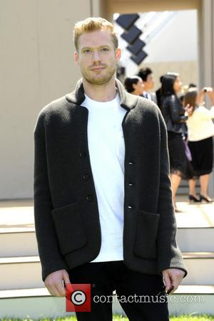 Sam Reid - London Fashion Week Men's Ready-To-Wear Summer 2015 - Burberry Prorsum - Celebrity Sightings - London, United Kingdom...