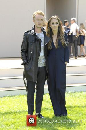 Tom Felton - London Fashion Week Men's Ready-To-Wear Summer 2015 - Burberry Prorsum - Celebrity Sightings - London, United Kingdom...