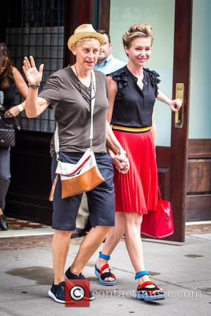Ellen DeGeneres and Portia de Rossi - Ellen DeGeneres and her wife Portia de Rossi leaving a hotel holding hands...