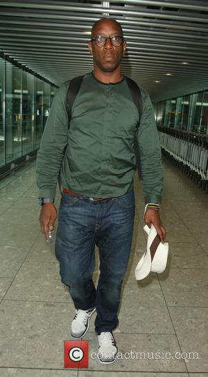 Ian Wright - Ian Wright arrives at Heathrow Airport after cutting short his role as ITV pundit during the 2014...