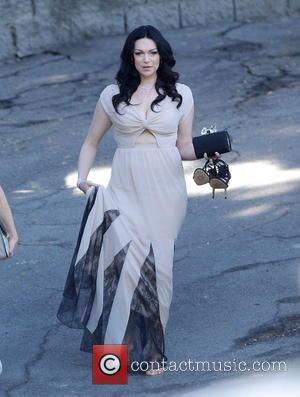 Laura Prepon - \Orange Is The New Black\ star Laura Prepon walks barefooted to an awaiting limo in a long...