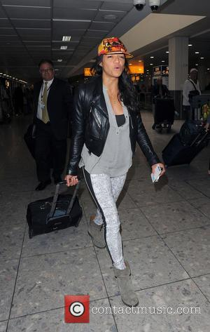 Michelle Rodriguez - Rita Ora and Michelle Rodriguez arriving at Heathrow Airport - London, United Kingdom - Thursday 19th June...