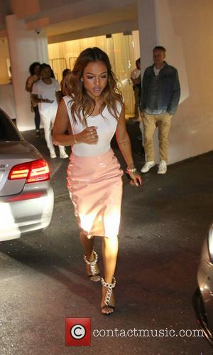 Karrueche Tran - Karrueche Tran, girlfriend of Chris Brown, was spotted with a mystery man at Scout Willis' 'Free the...