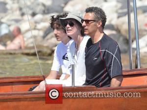 John Turturro, Katherine Borowitz and Diego Turturro - John Turturro and his family were spotted boating and swimming off the...