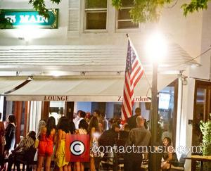 Leonardo DiCaprio - A group of women stand outside 75 Main restaurant in the Hamptons, New York, where actor Leornardo...