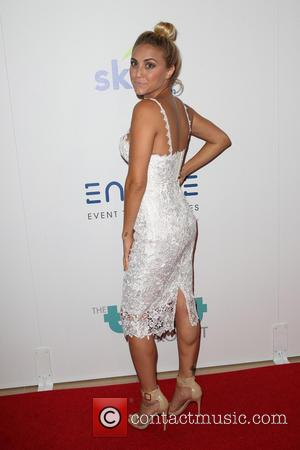 Cassie Scerbo - 5th Annual Thirst Gala hosted by Jennifer Garner in partnership with Skyo and Relativity's \Earth To Echo\...