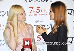 Elle Fanning and Angelina Jolie - 'Maleficent' photocall at Grand Hyatt Tokyo - Tokyo, Japan - Tuesday 24th June 2014