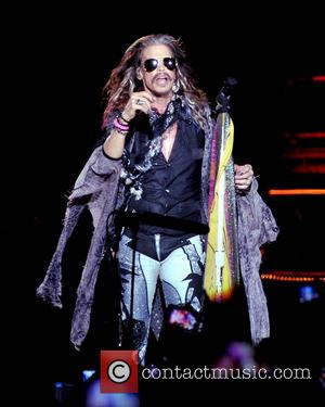 Steven Tyler, Joe Perry and Aerosmith - Aerosmith performing live on stage on their 'Let Rock Rule The World' tour...
