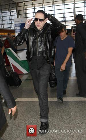 Marilyn Manson and Brian Hugh Warner - Marylin Manson (real name Brian Hugh Warner) arrives at Los Angeles International Airport...