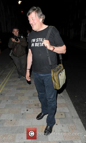 Stephen Fry - Stephen Fry leaves the Chiltern Firehouse restaurant on a mobility scooter complete with 'I Love Dogging' sticker....