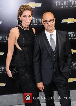 Stanley Tucci and Felicity Blunt - \Transformers: Age of Extinction\ New York Premiere at The Ziegfeld Theater - New York,...