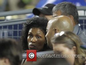 Omarosa Manigault - Celebrities attend the Los Angeles Dodgers v St. Louis Cardinals baseball game held at Dodger Stadium. The...