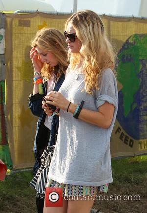 Lily James and Laura Carmichael - Glastonbury Festival 2014 - Celebrity sightings and atmosphere - Day 4 - Glastonbury, United...