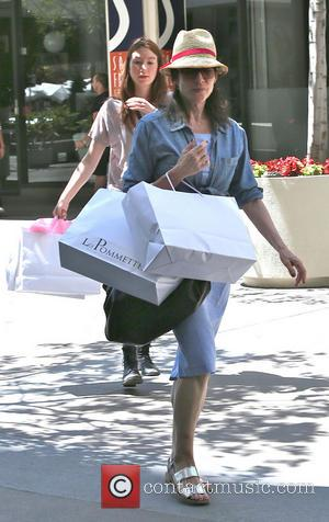Katey Sagal - Katey Sagal wearing a straw hat laden with shopping bags after a spree on Robertson Boulevard including...