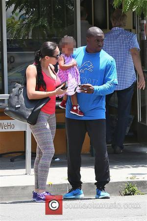 Briseis Bush, Reggie Bush and Lilit Avagyan - Reggie Bush with his wife Lilit Avagyan and baby daughter Briseis leave...