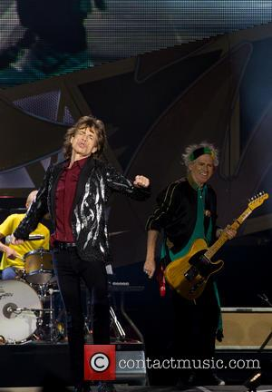 Mick Jagger - The Rolling Stones performing live on stage on their '14 ON FIRE' tour at the Tele2 Arena...