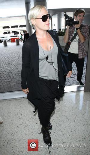 Pink, Alecia Moore and Alecia Moore Hart - Pink at Los Angeles International Airport (LAX) - Los Angeles, California, United...