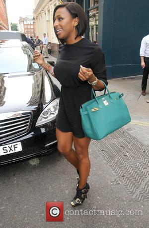 Alexandra Burke - Alexandra Burke wearing very short black dress arrives at the Adelphi Theatre? stage door to appear in...