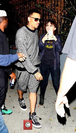 Chris Brown - Chris Brown and Karrueche Tran leaving the...