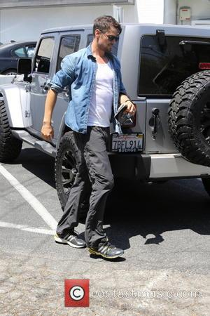 Josh Duhamel - A bearded Josh Duhamel parks his Jeep and visits his office in Brentwood carrying a tablet -...