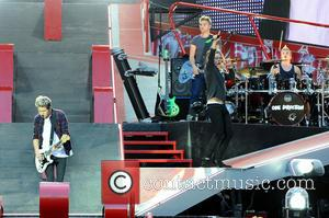 One Direction, Niall James Horan and Harry Edward Styles - One Direction performing live in concert during their 'Where We...