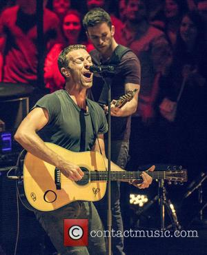 Coldplay and Chris Martin - Coldplay performing live in concert at the Royal Albert Hall - London, United Kingdom -...