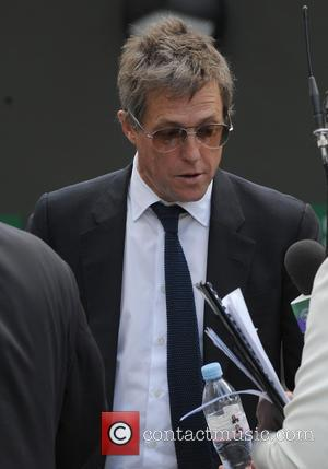Hugh Grant - 2014 Wimbledon Championships held at the All England Club - Celebrity Sightings - Day 9 - London,...