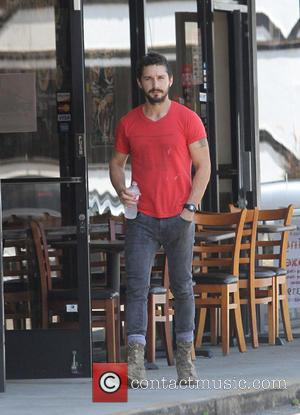 Shia LaBeouf - A bearded Shia LaBeouf wearing an old red 'Mighty Alpha Superstars 1981-1982' t-shirt leaves an AA (Alcoholics...