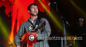 James Blunt - James Blunt performing live on stage and crowd surfs at Epsom Racecourse - Epsom, United Kingdom -...