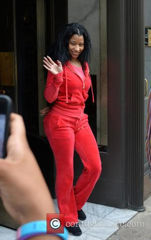 Nicki Minaj - Nicki Minaj, dressed down in an all red Juicy tracksuit, leaves her hotel to rehearse for the...