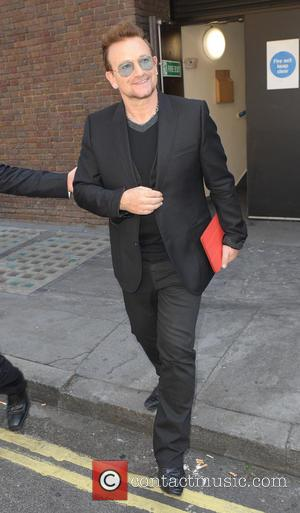 Bono - Bono leaving the Hilton hotel - London, United Kingdom - Friday 4th July 2014
