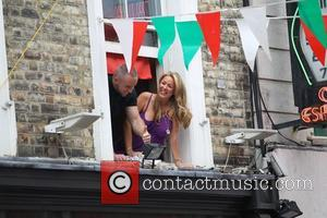 Claire Sweeney - Claire Sweeney listens in on a performance by Suggs and 'Soho Hobo' Tim Arnold to celebrate Bar...