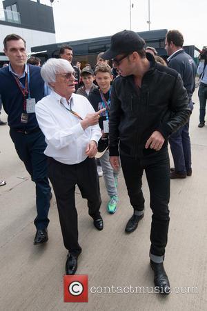 Bernie Ecclestone and Jude Law - Silverstone F1 Grand Prix, race day. - Silverstone, United Kingdom - Sunday 6th July...