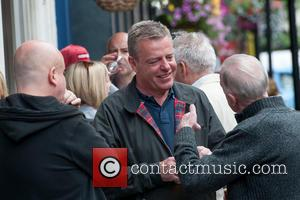Suggs and Graham McPherson - Madness frontman Suggs has a drink in Soho with friends - London, United Kingdom -...