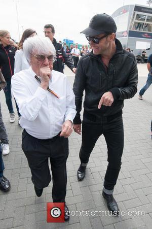 Jude Law and Bernie Ecclestone - 2014 Formula 1 Santander Silverstone British Grand Prix - Race Day - Celebrity Sightings...