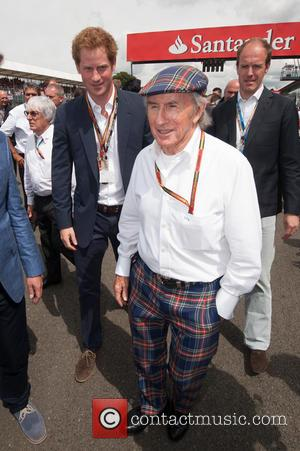 Prince Harry and Sir Jackie Stewart - 2014 Formula 1 Santander Silverstone British Grand Prix - Race Day - Celebrity...