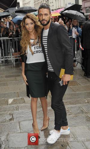 Nabilla Benettia and Thomas Vergara - Paris Fashion Week Haute Couture Fall/Winter 2014-2015 - Jean Paul Gaultier - Outside Arrivals...